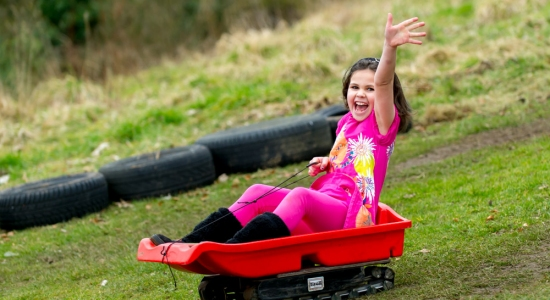 Grass Sledging at Muddy Boots